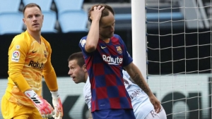 Barcelona draws to Celta in title battle with Real Madrid